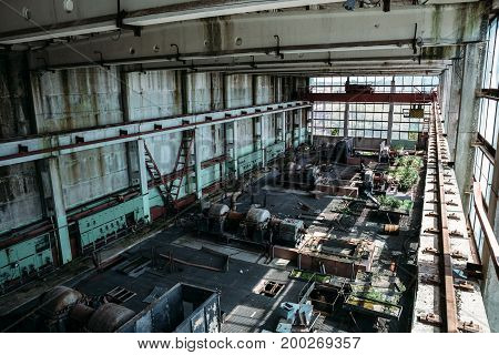 Large workshop in an abandoned factory, abandoned industrial concept, toned