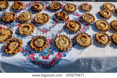 Home baked pies displayed at the local farmer's market.