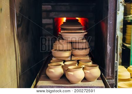 Firing of pottery in the special oven