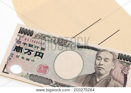 Japanese money and salary envelope on white background