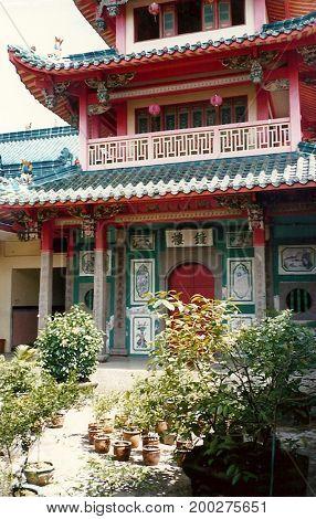 SINGAPORE / CIRCA 1990: A courtyard and pagoda in the Kwan Im Thong Hood Cho Temple.