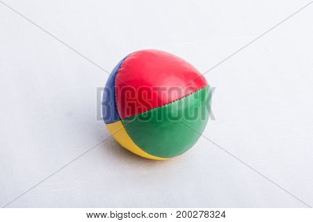 A juggling ball made of leather on a white surface