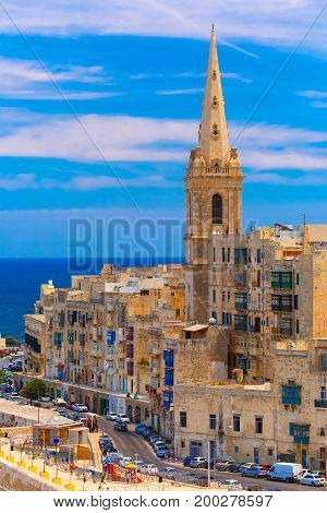 View from above of roofs and St. Paul's Anglican Pro-Cathedral, Valletta, Capital city of Malta