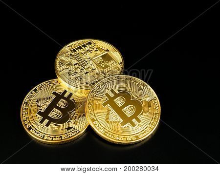 Golden bitcoin on black background. Bitcoin cryptocurrency