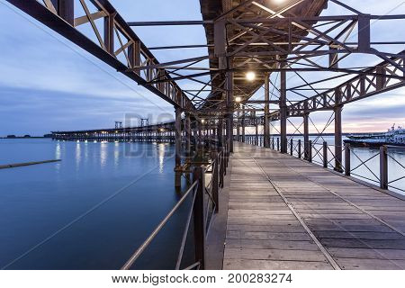 Old ironwork quay - Muelle del Tinto - at the river Rio Tinto in the city of Huelva. Andalusia Spain