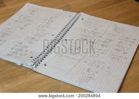 Spiral bound math notebook open to messy math work