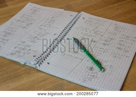 Math Notebook Open to Messy Handwriting With Pencil