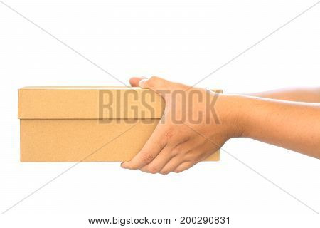 Delivery concept Hand holding paper box isolated on white background