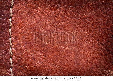 Leather background with excellent texture for design  and a string of threads