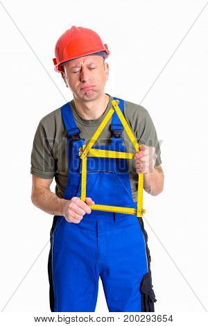 Dissatisfied Worker With Yardstick- House