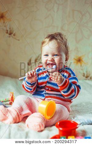 Child in kindergarten. Kid in nursery school. Little girl preschooler playing