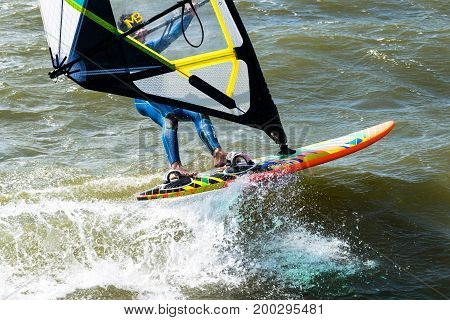 Windsurfer in the sea man on windsurf conquering the waves.