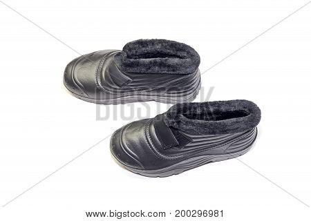Men's black boots for cottages closeup on a white background