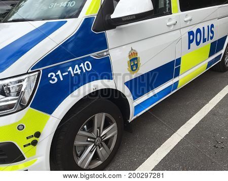 Lidingo Sweden - July 25 2017: A close-up side view of a Volkswagen van in service for the Swedish police.
