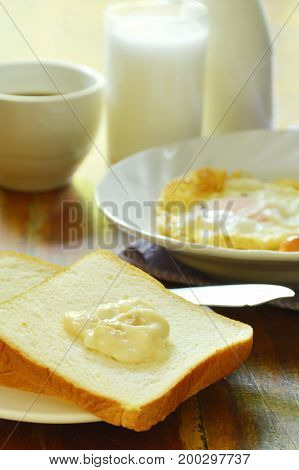 slice bread with fried egg and pork sausage eat couple coffee cup breakfast set