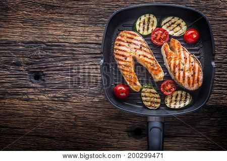 Salmon. Grilled Fish Salmon. Grilled  Salmon Steak In Grill Pan On Rustic Wooden Table