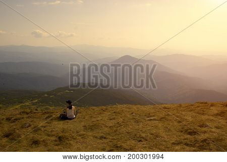 Woman is resting in the mountains chill out