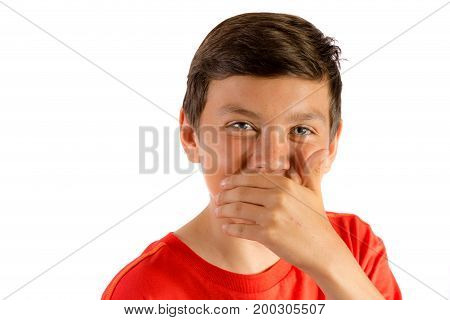 Young teenage boy isolated on white laughing behind his hand