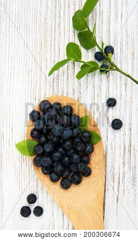 Blueberries On A Old Wooden Background