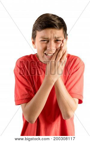 A young teenage boy isolated against white background with tooth ache