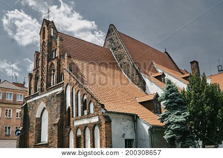 Fragment of the facade of the medieval Gothic church in Poznan