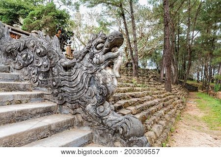 Dragon on stairs in Tomb of Tu Duc emperor in Hue Vietnam - A UNESCO World Heritage Site. Dragon skin texture background