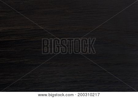 Black wood texture background. High resolution photo.