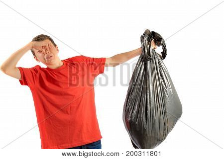 Young teenage boy isolated on a white background with smelly rubbish