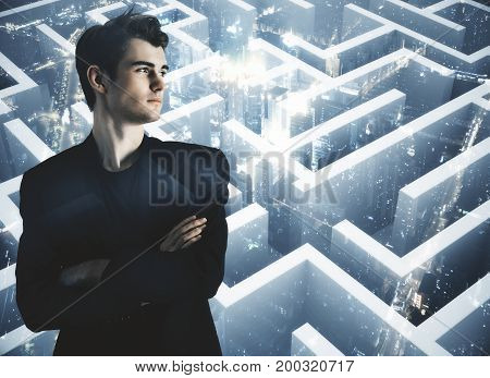 Thoughtful young businessman on abstract city background with maze labyrinth. Path concept. Double exposure