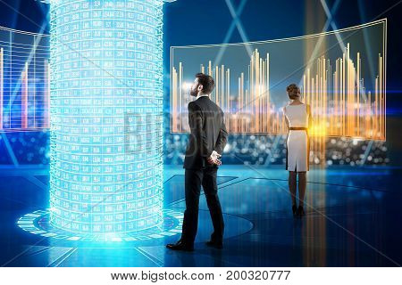 Back view of young businessman and woman looking at digital business screens and holograms in futuristic interior. Media concept. 3D Rendering