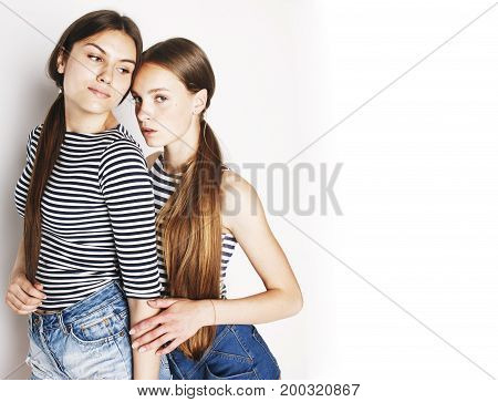 two cute teenagers having fun together isolated on white, girls friends