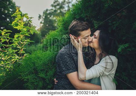 Couple in love laughing looking at each other in the park