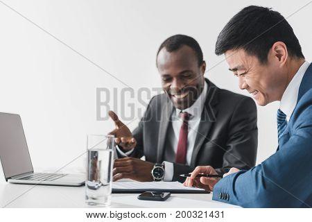 Multiethnic Businessmen Discussing Contract