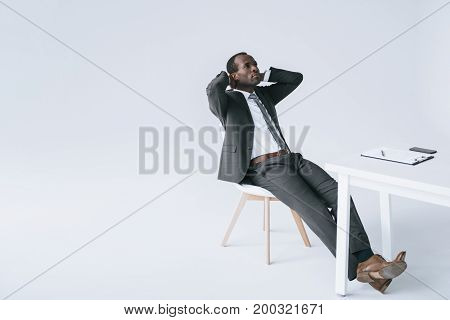 African American Businessman Resting At Workplace