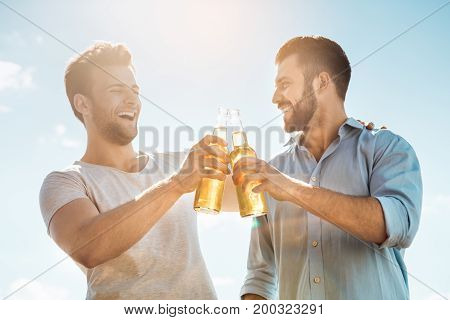 Group of people having barbecue party drinking beer