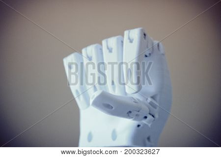 Robot hand fingers from plastic close-up conceptual