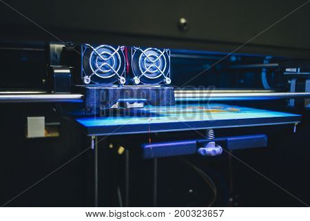 Objects printed by 3d printer. Automatic three dimensional 3d printer performs plastic modeling in laboratory. Progressive modern additive technology. Copy space