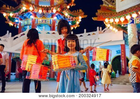 KUALA LUMPUR MALAYSIA - SEPTEMBER 15: Little girls pose with paper lanterns at Thean Hou Temple at the lantern parade during Mid-Autumn festival on September 15 2016 in Kuala Lumpur Malaysia.