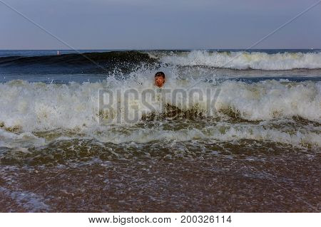 Middle-aged Man Swim In The Ocean