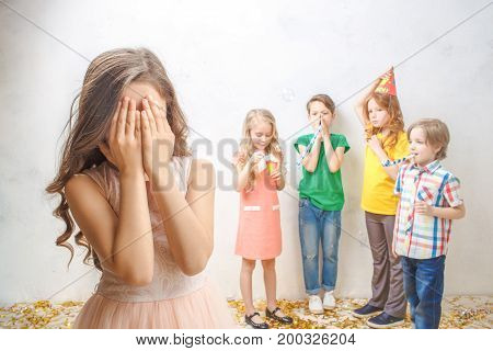 Little children friends studio isolated on white birthday celebration together surprise