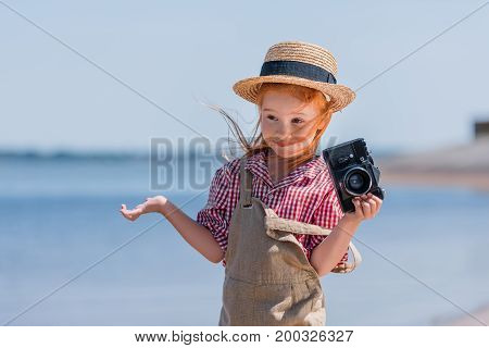 Redhead Child With Camera