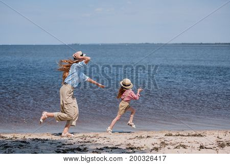 Happy Mother And Daughter On Beach