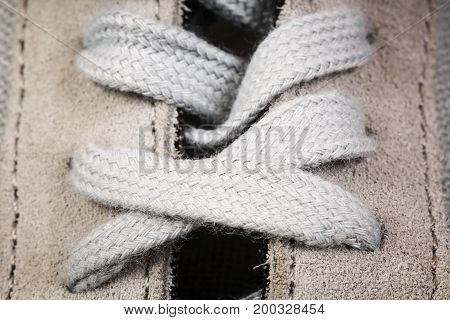 Men's sports shoes with laces close up background