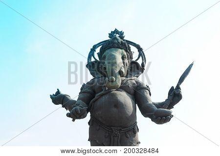 Hindu God Ganesha,The Lord of Success .Large Ganesha monument against blue sky