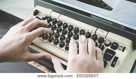 Man's Asian Hand Typing Vintage Retro Typewriter Machine Work Writer On Office Desk. Close Up Of Man
