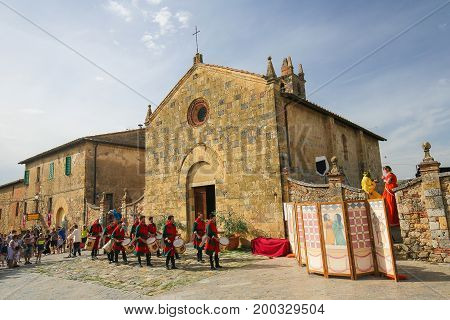 MONTERIGIONNI ITALY - JULY 9 2017: Medieval reenactment on Piazza Roma in Monteriggioni a comune in the province of Siena in the Italian region Tuscany.