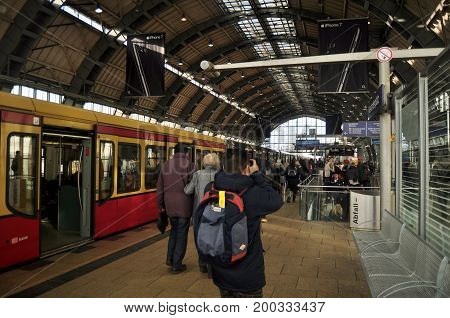 German People And Foreigner Travelers Passengers Walking Up And Down Train Inside Of Berlin Hauptbah