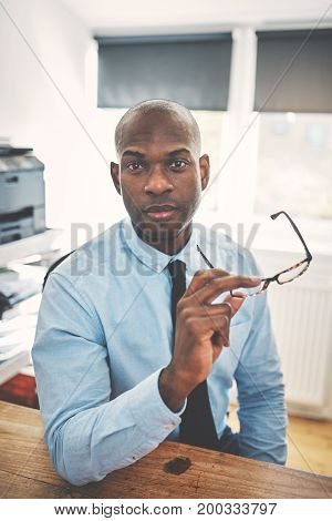 Confident And Focused African Businessman Sitting In His
