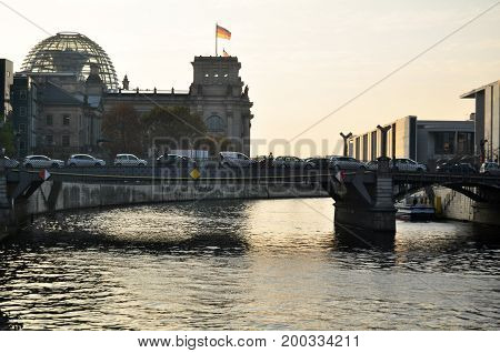 Traffic Jam On The Bridge Crossover Spree River With Reichstag Building