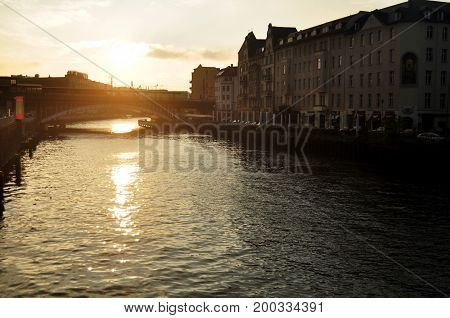 View Landscape And Cityscape With Weidendammer Bridge And Spree River In Sunset Time At Berlin City